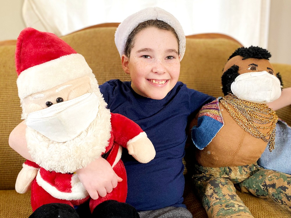 Nine year old with Santa and Mr. T (who are wearing masks)