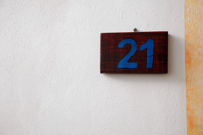 """""""21"""" sign on a wall (photo by Peyri Herrera via Flickr/Creative Commons)"""