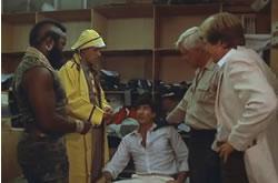 The team interrogates a sweatshop guy