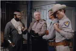 The team puts on their sheriff badges