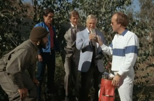 """The A-Team examines some """"funny money"""" on a golf course"""
