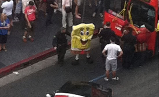Someone in a SpongeBob suit being questioned by authorities