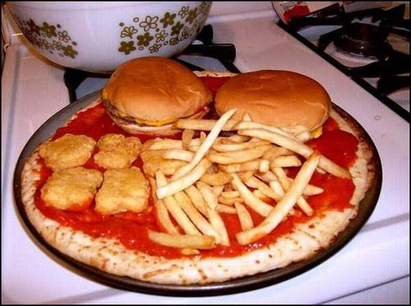 Pizza with burgers and fries on it
