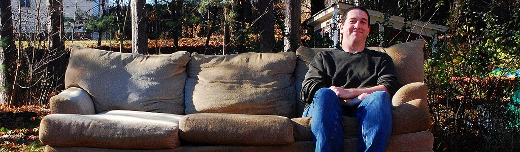 Brady sitting on a couch in his yard
