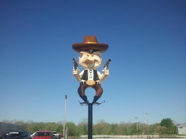 Giant gunfighter figure