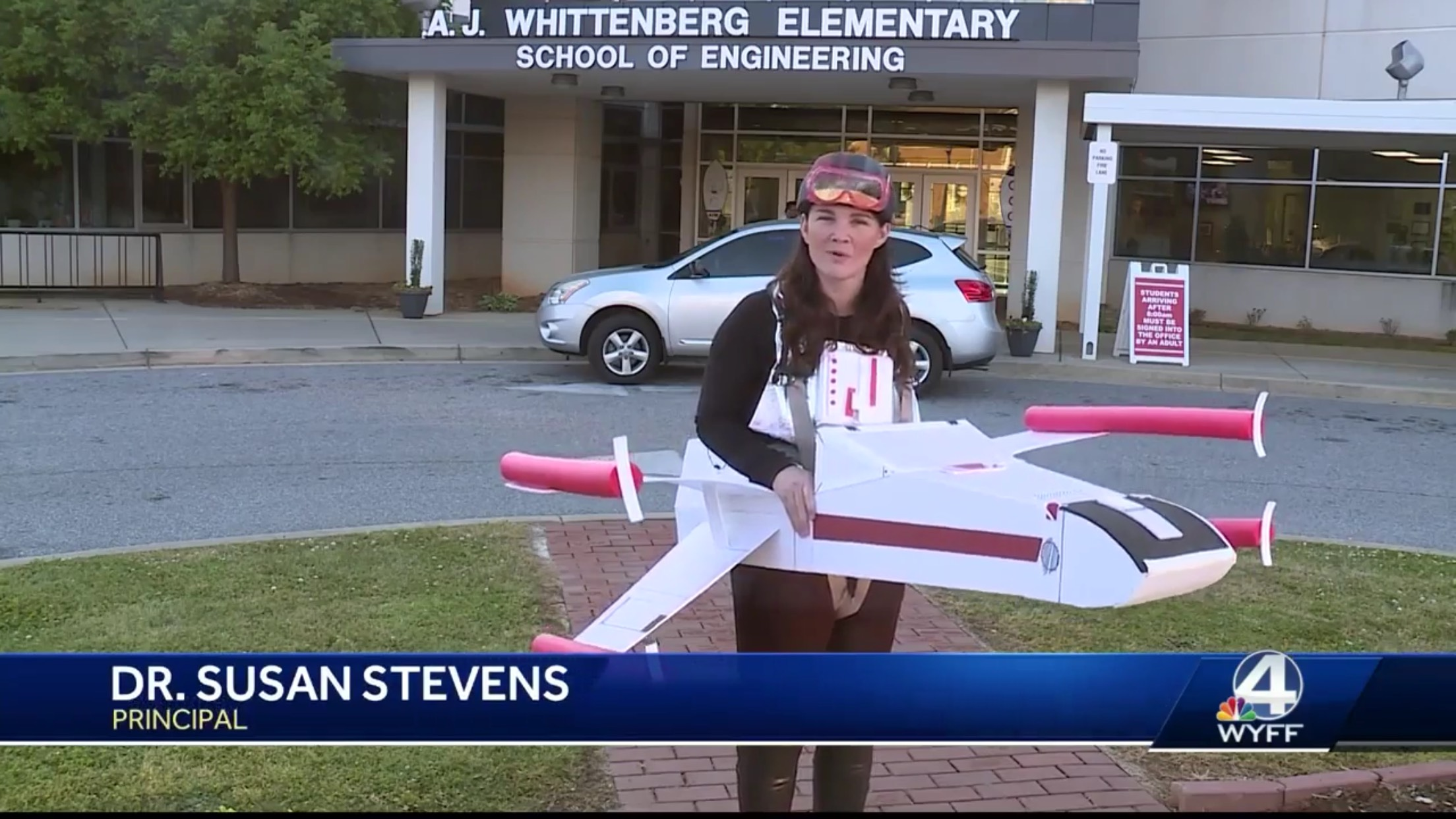 Dr. Susan Stevens: Principal. She is dressed like an X-Wing Fighter from Star Wars