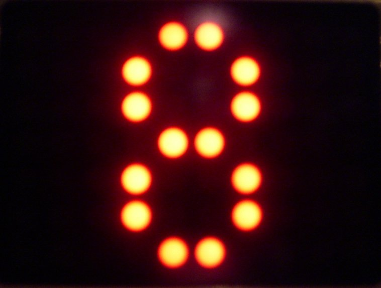 The number 8 lit up on a scoreboard (Photo by duncan c via Flickr/Creative Commons https://flic.kr/p/6dzMX)
