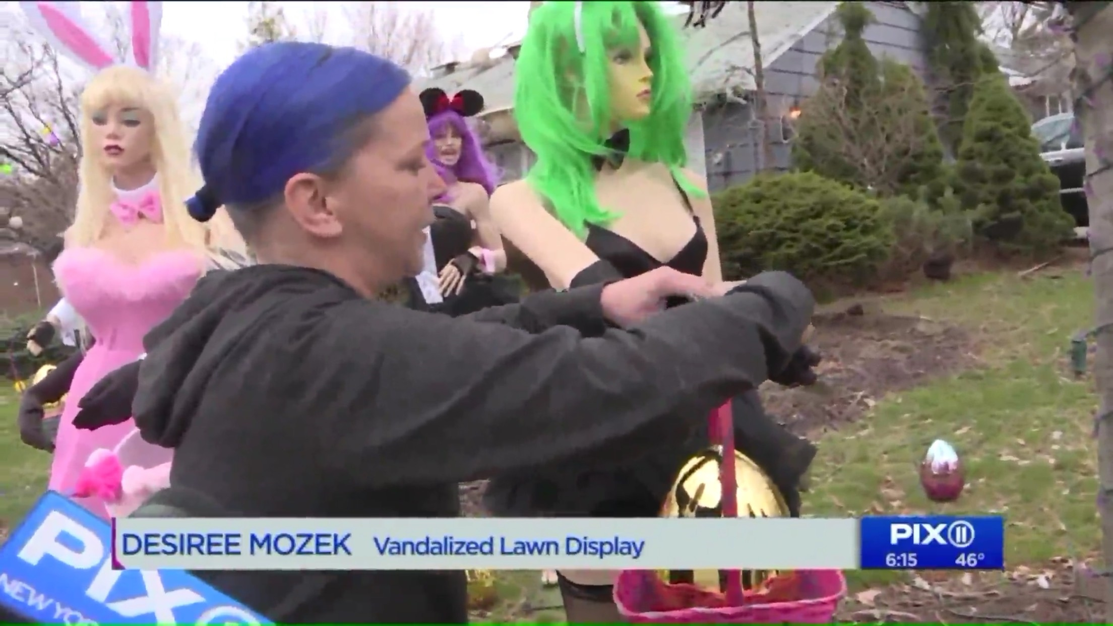Desiree Mozek: Vandalized Lawn Display. (The display is female mannequins in lingerie.)