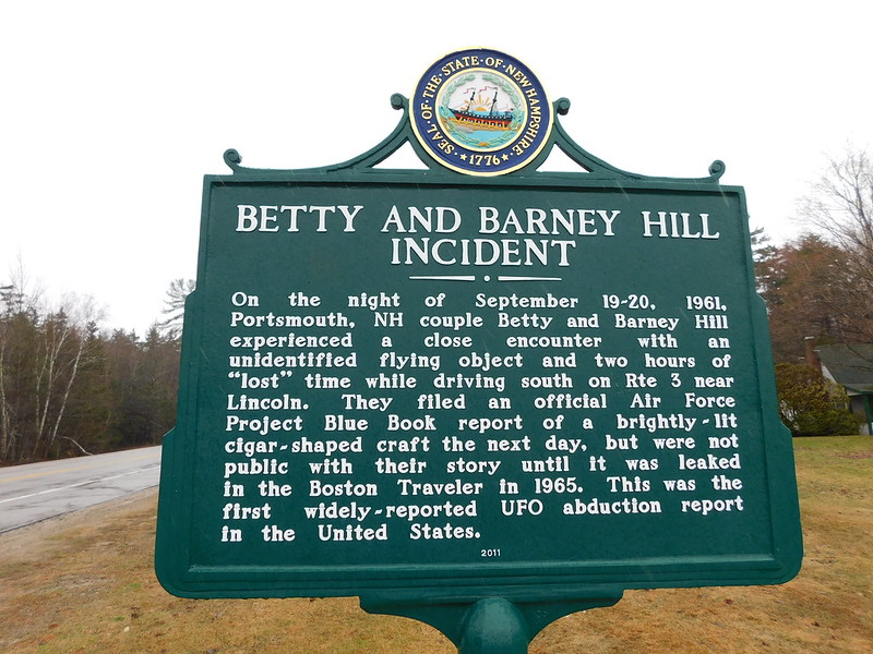 """Green historic sign describes the """"Betty and Barney Hill Incident,"""" known as """"the first widely-reported UFO abduction report in the United States."""" (Photo by Jimmy Emerson, DVM via Flickr/Creative Commons https://flic.kr/p/TDj2Nw)"""