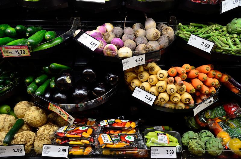 Vegetables on black grocery store shelves (via Flickr https://flic.kr/p/AqjVxn)