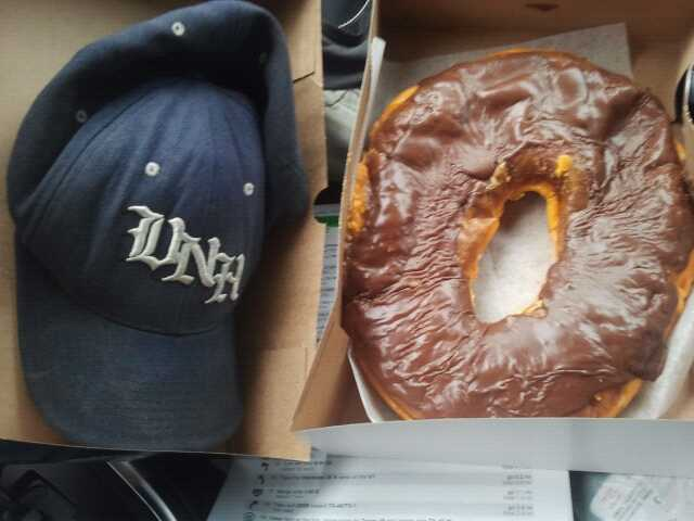 "A ""Texas-sized doughnut"" with chocolate frosting on top. It's the same size as my baseball cap."