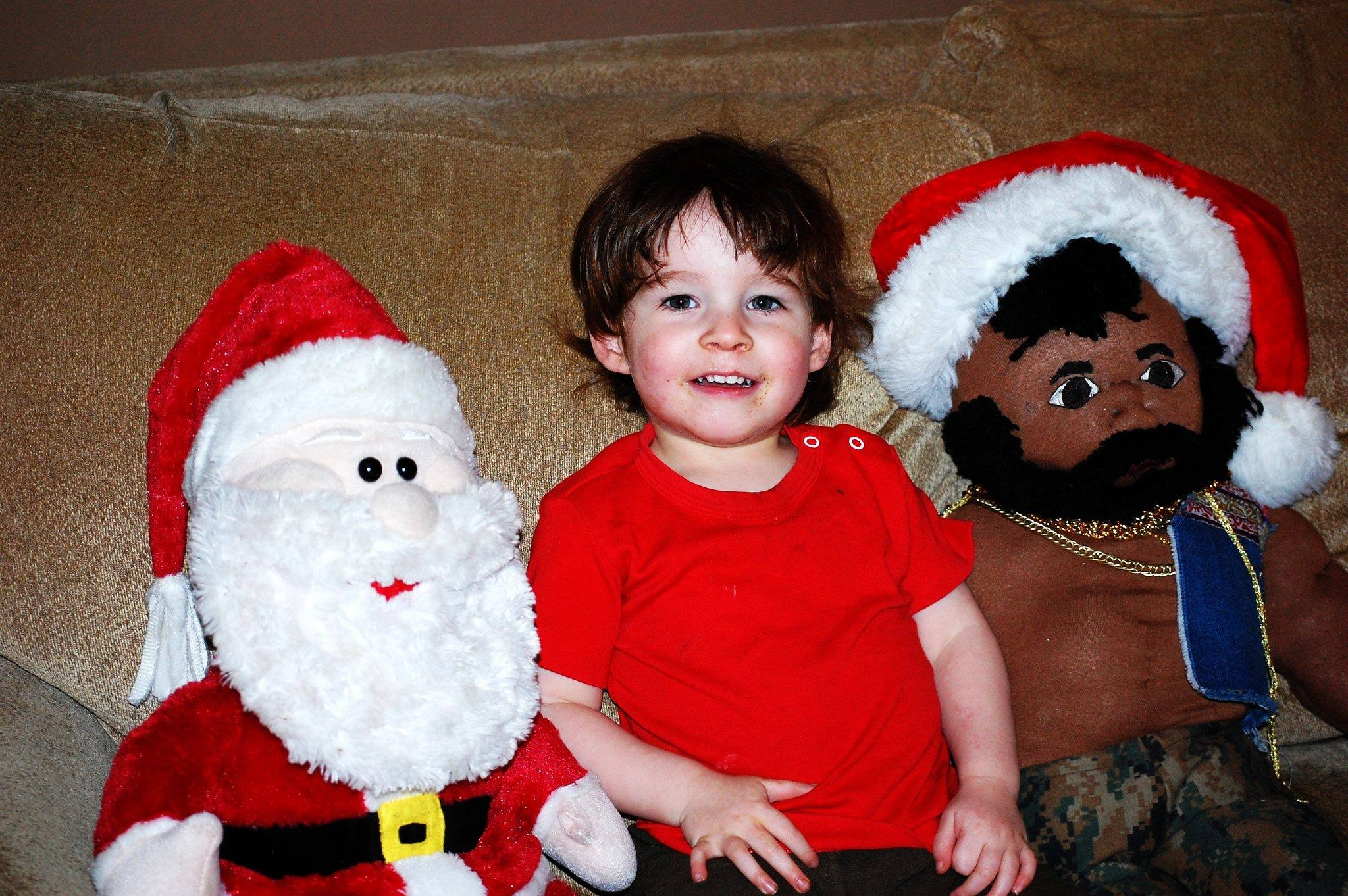 One year old with Santa and Mr. T