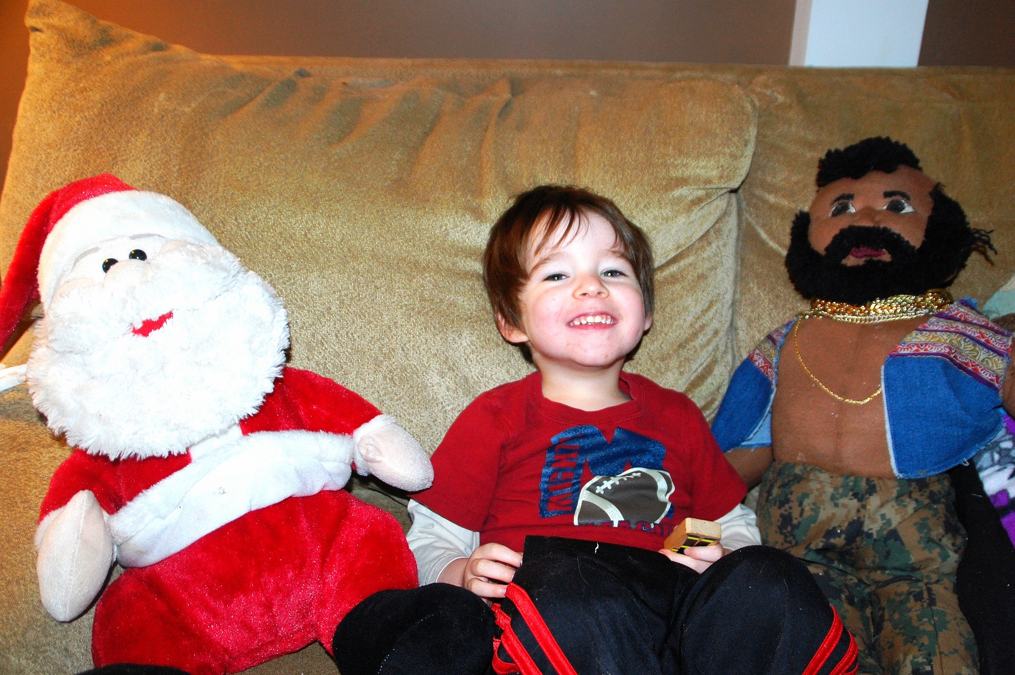 Two year old with Mr. T and Santa