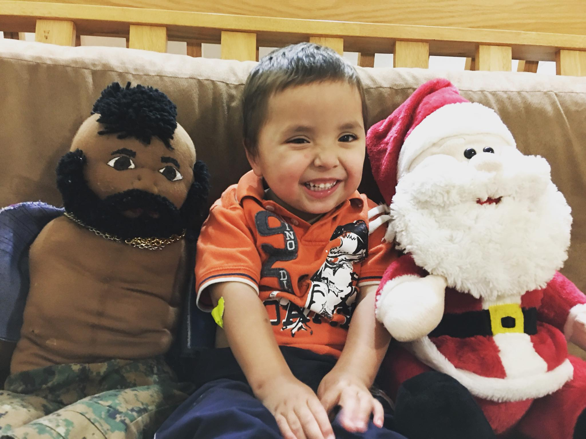 Almost three year old with Mr. T and Santa