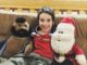 Six year old with Mr. T and Santa