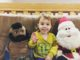 Almost two year old with Mr. T and Santa