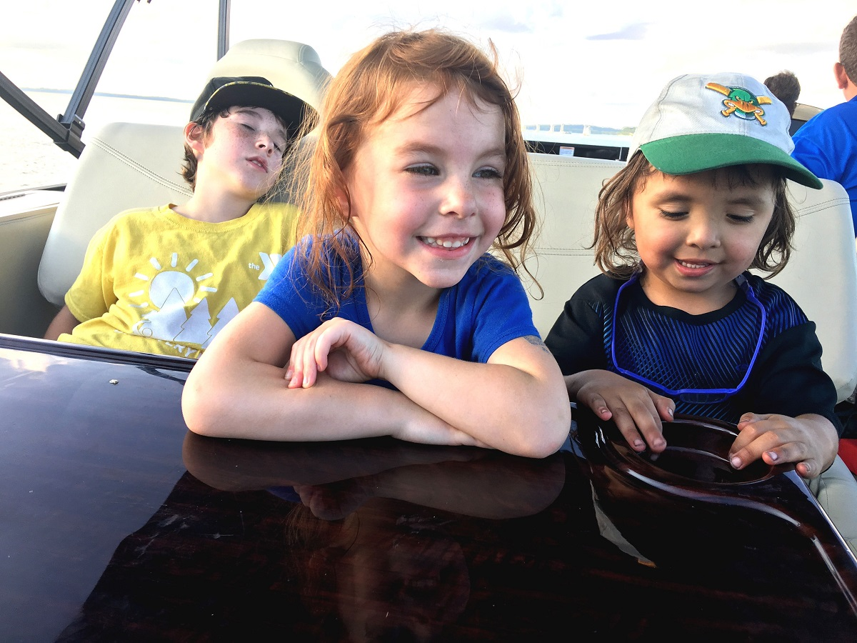 Carlson Kids go for a boat ride on Lake Mendota