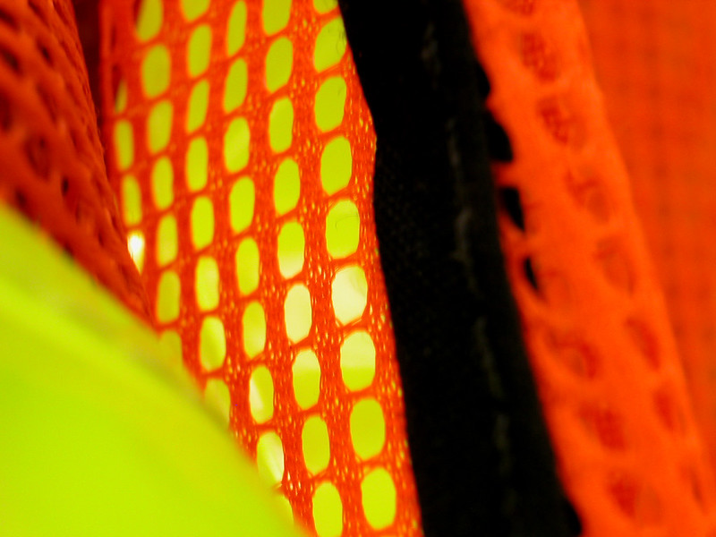 Close up on a safety vest with day glo yellow and orange colors. (Photo by swirlingthoughts via Flickr/Creative Commons https://flic.kr/p/d5u74)