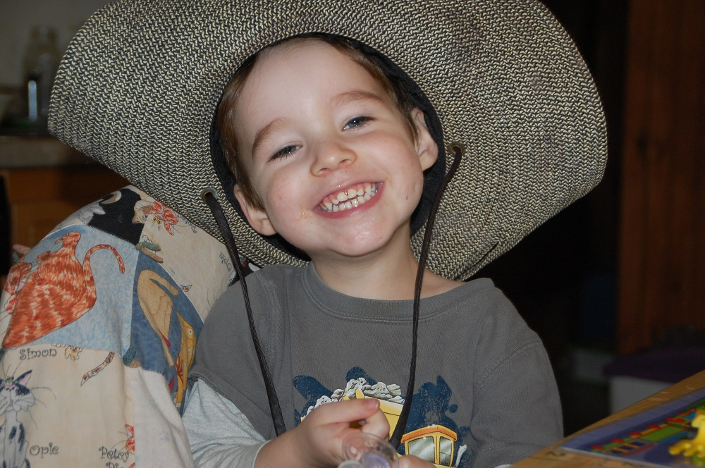 Two year old and his giant hat