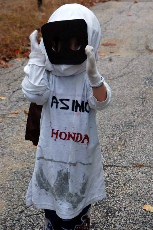 "Three year old as ""humanoid robot ASIMO"""