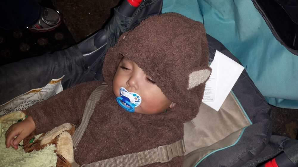 Sleepy baby boy in his bear costume