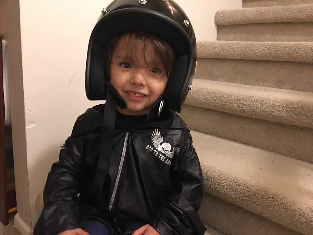 Three year old is a motorcycle dude