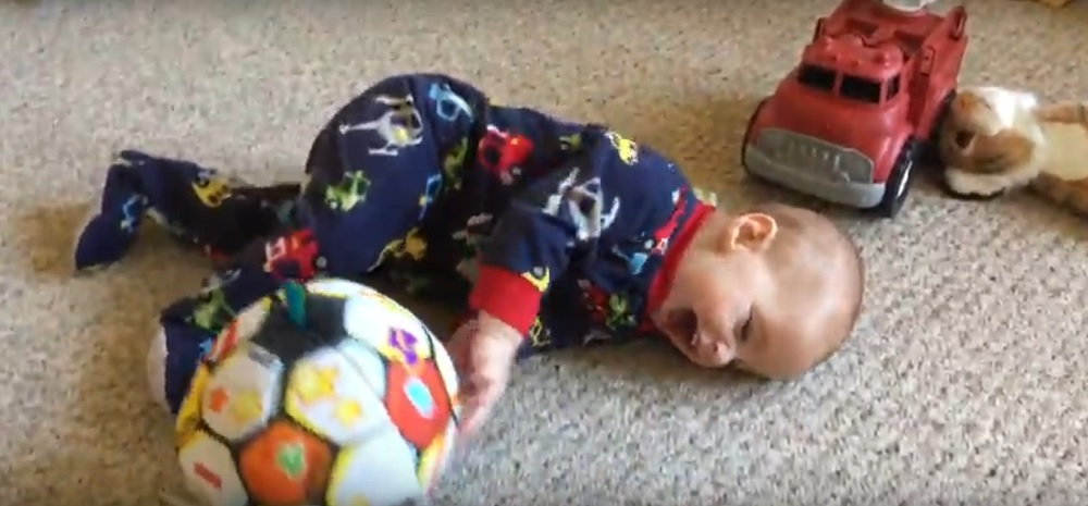 Baby girl plays with her ball