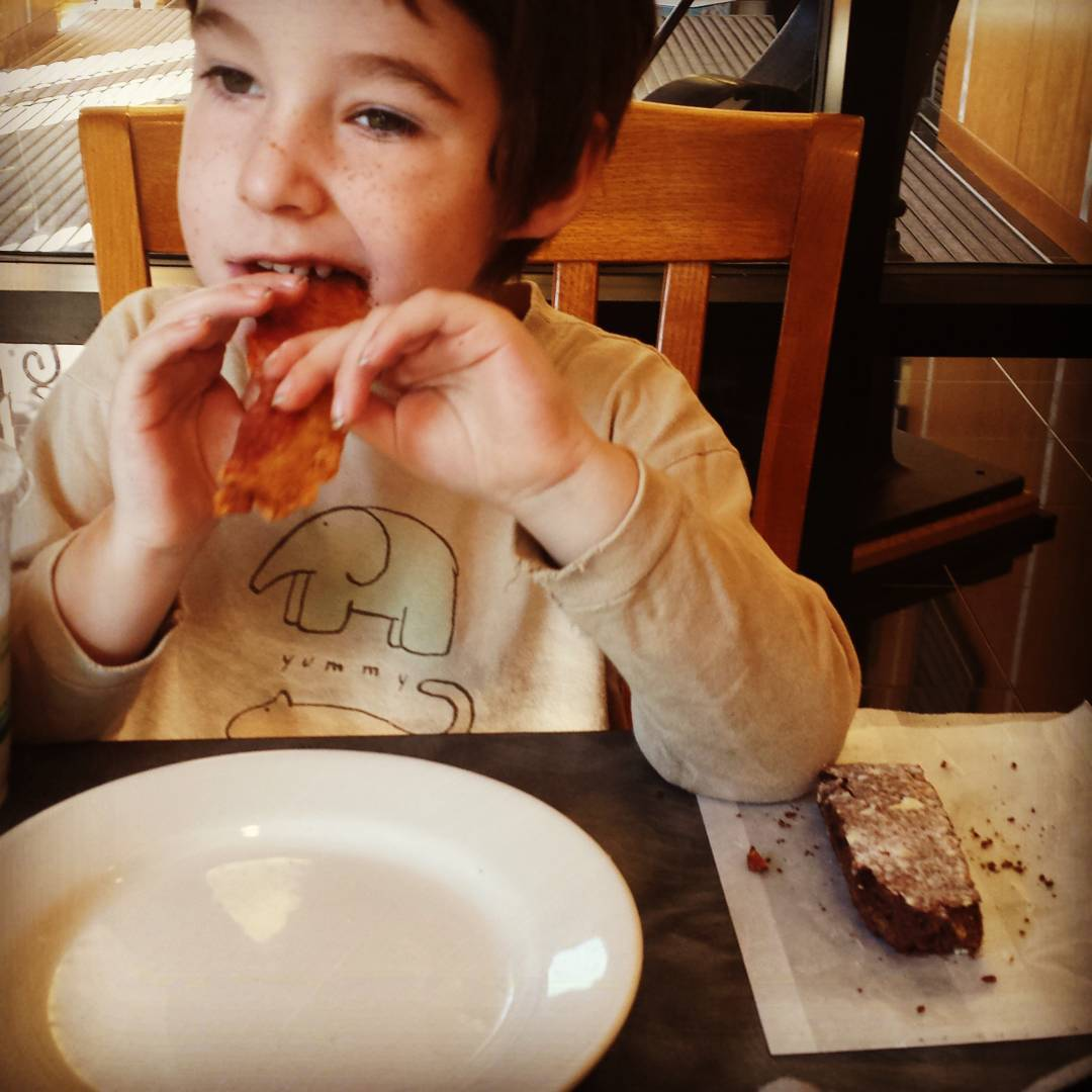 Four year old eats bacon and biscotti