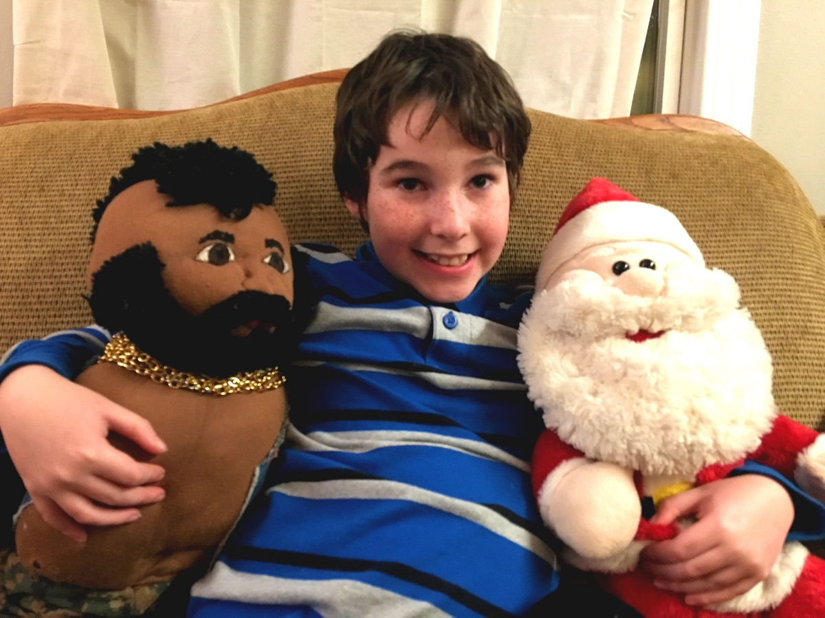 Eight year old with Santa and Mr. T