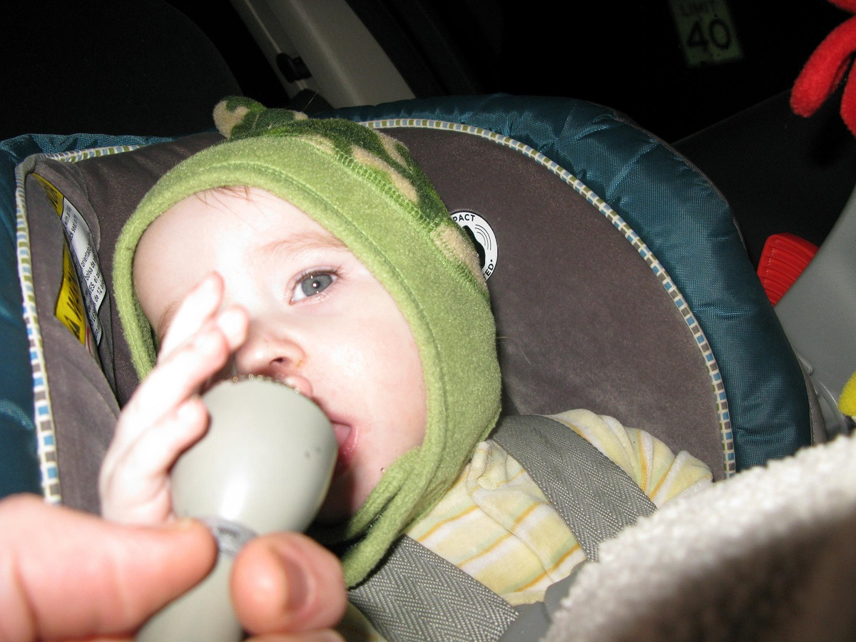 Baby boy tries to eat the microphone