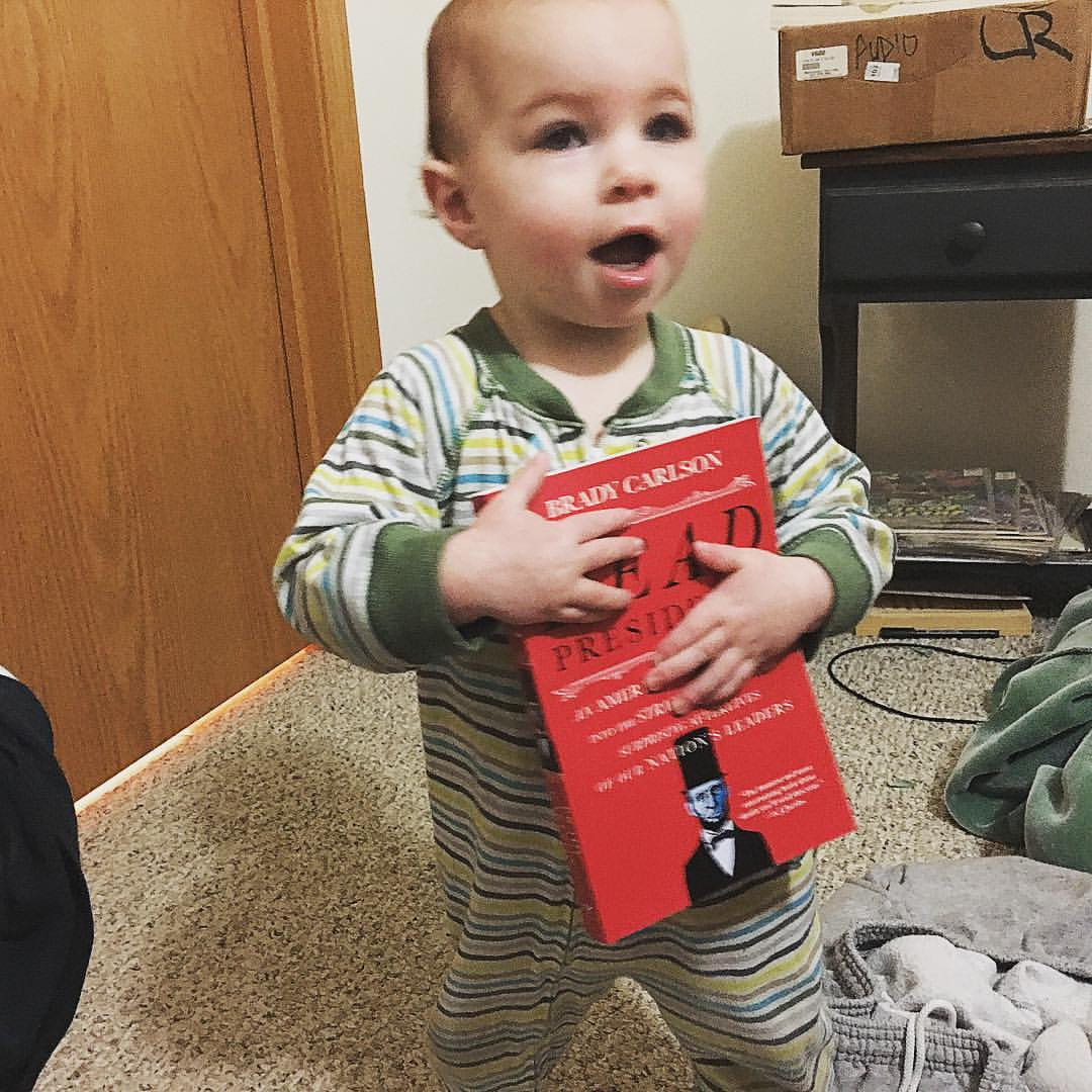 One year old carries around her paperback of DEAD PRESIDENTS