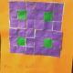 "Orange, purple and green quilt pattern named ""Mr. Eyeballs"""