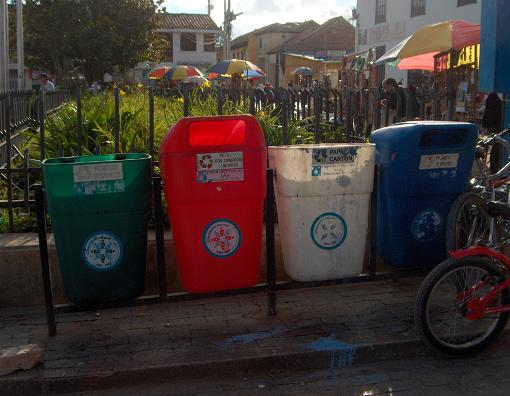 Four recycling bins on a curb in Colombia. (Photo by adrimcm https://flic.kr/p/54WQc3)