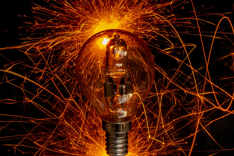Bright electric sparks inside and outside of a light bulb. (Photo by mario forcherio via Flickr/Creative Commons https://flic.kr/p/2jEg9q3)