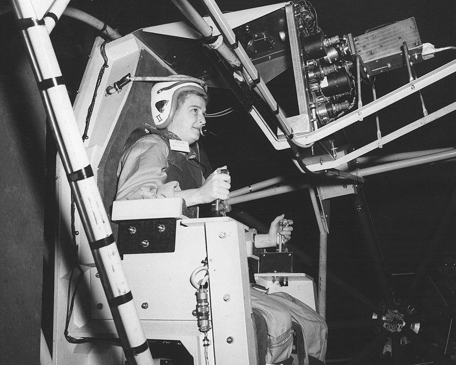 Jerrie Cobb testing Gimbal Rig in the Altitude Wind Tunnel, AWT in April 1960. (NASA via Wikicommons https://commons.wikimedia.org/wiki/Category:Jerrie_Cobb#/media/File:Jerrie_Cobb,_Lady_Pilot,_testing_Gimbal_Rig_in_AWT_-_GPN-2000-000379.jpg)