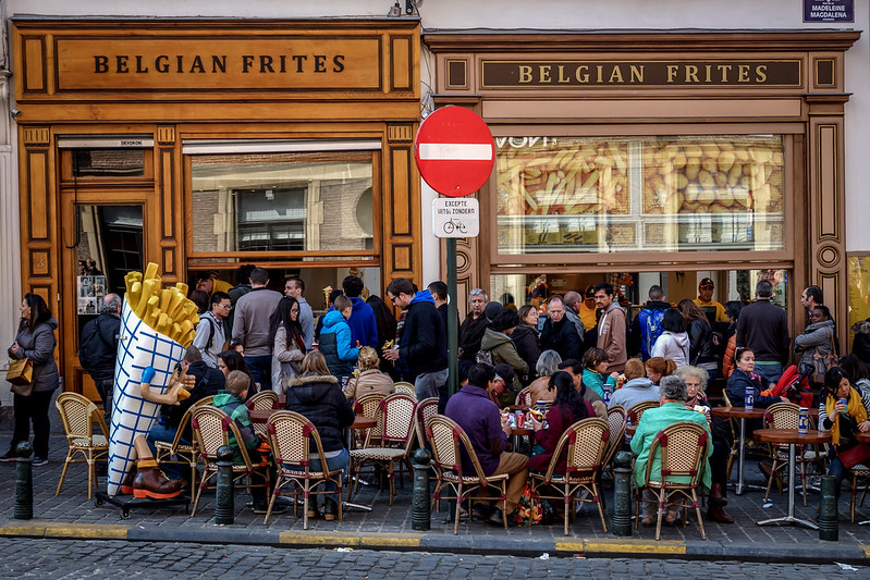 People in Belgium eating frites (photo by janmennens via Flickr/CC)