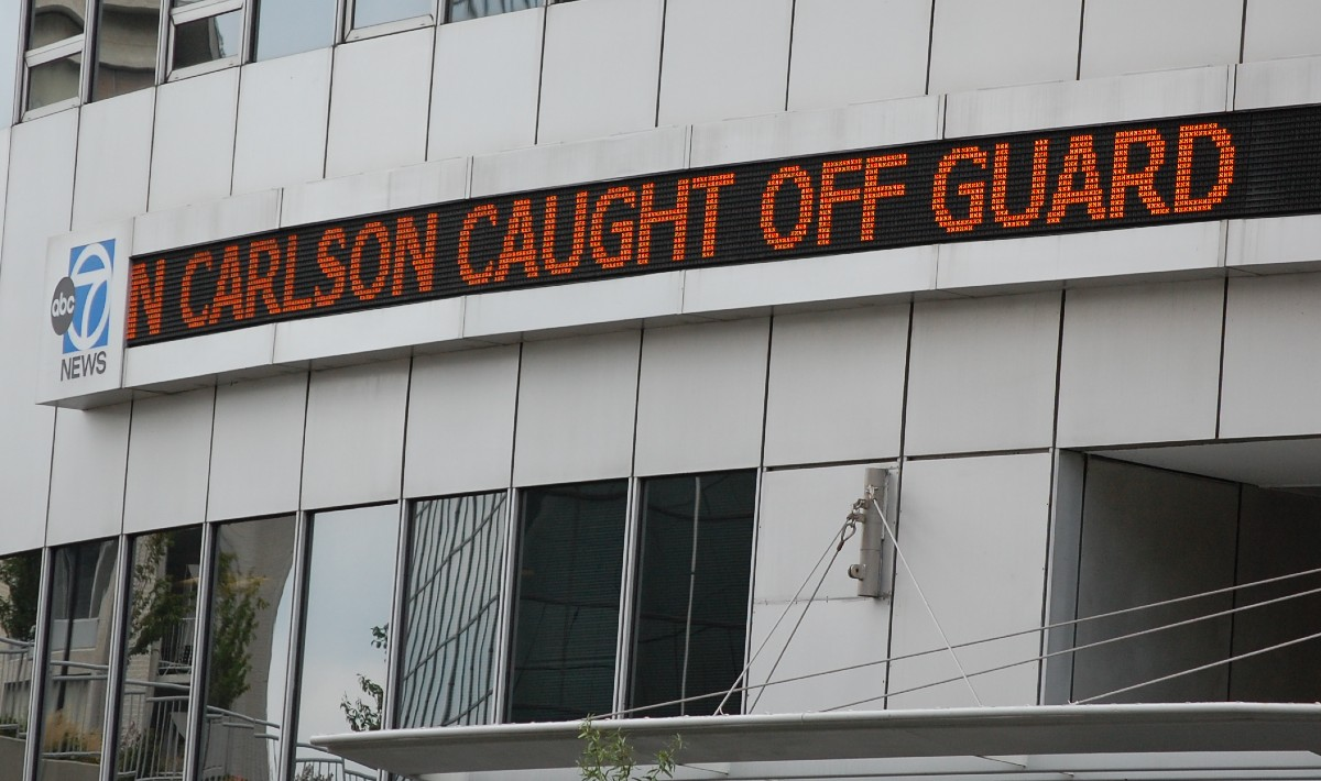 "news ticker: ""CARLSON CAUGHT OFF GUARD"""