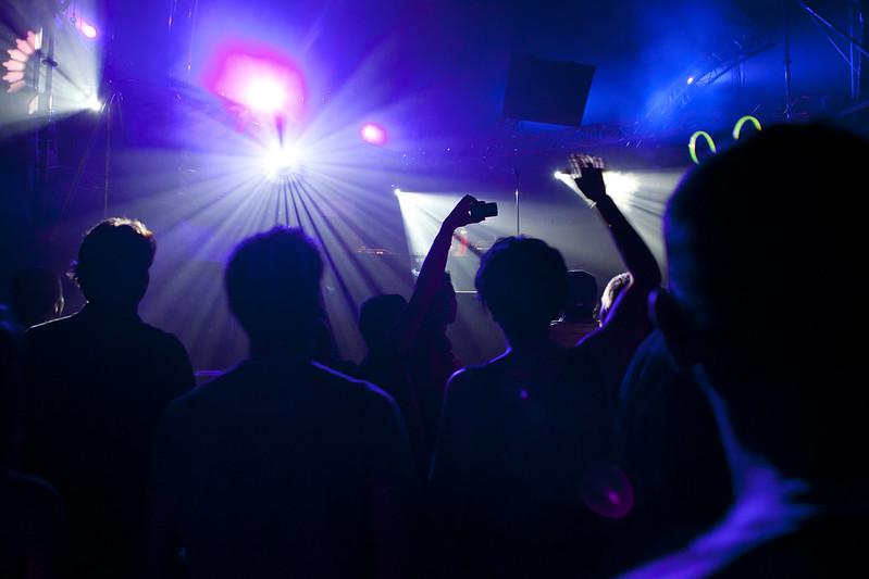 People dancing in a dark dance club. (Photo by Patrick Savalle via Flickr/Creative Commons https://flic.kr/p/spxbjL)