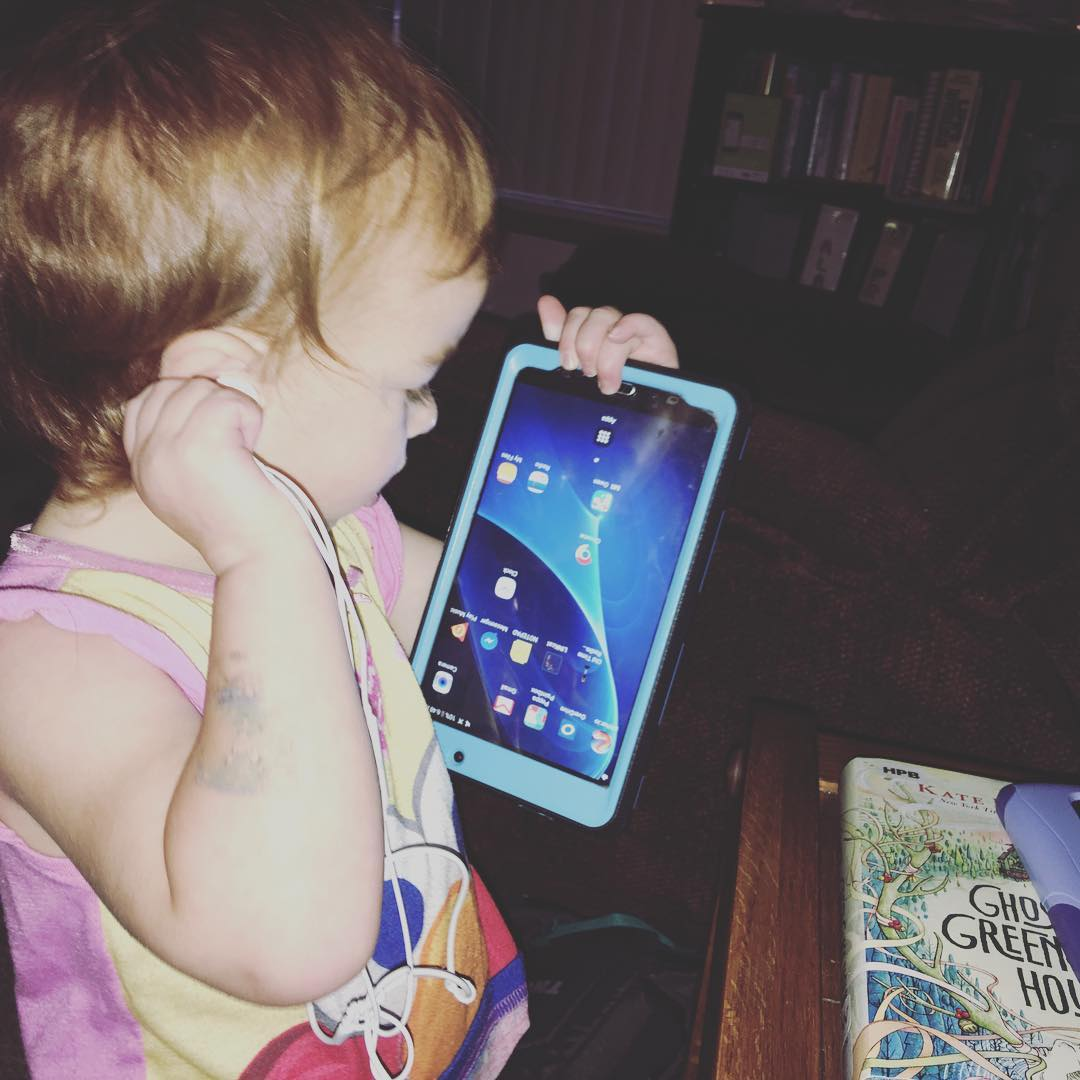One year old helps herself to mama's tablet