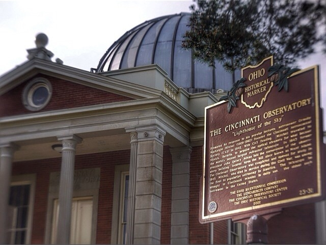 Cincinnati Observatory, an old brick building with pillars in front and a large translucent-looking dome on top. (Photo by 5chw4r7z via Flickr/Creative Commons https://flic.kr/p/nuWadq)