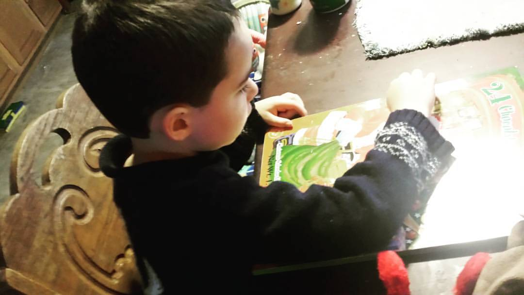 Four year old opening Advent calendar