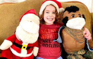 Four year old with Santa and Mr. T (who are wearing masks)
