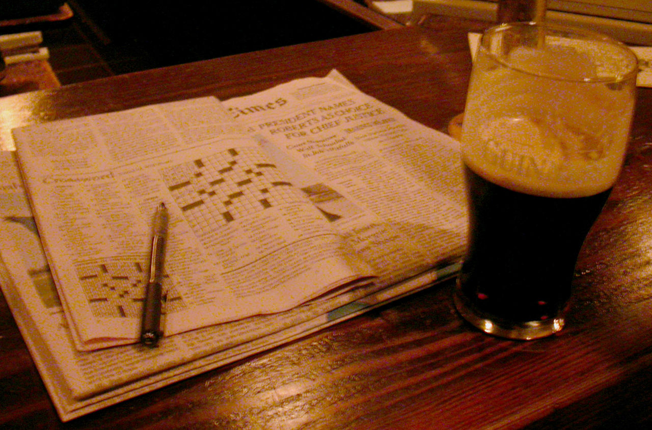 Crossword puzzle and a Guinness (photo by falsecognate via Flickr/Creative Commons)