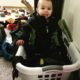 One year old sitting in a laundry basket