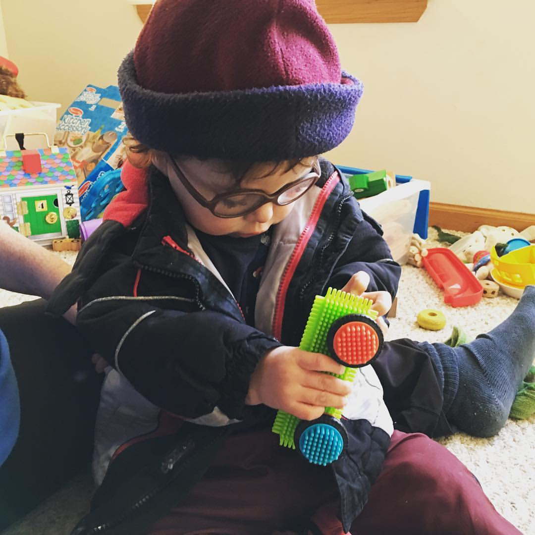 Two year old playing with bristle blocks