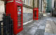 Red phone box in a town square, with another a few paces away. (Photo by It's No Game via Flickr/Creative Commons https://flic.kr/p/zmKNFE)
