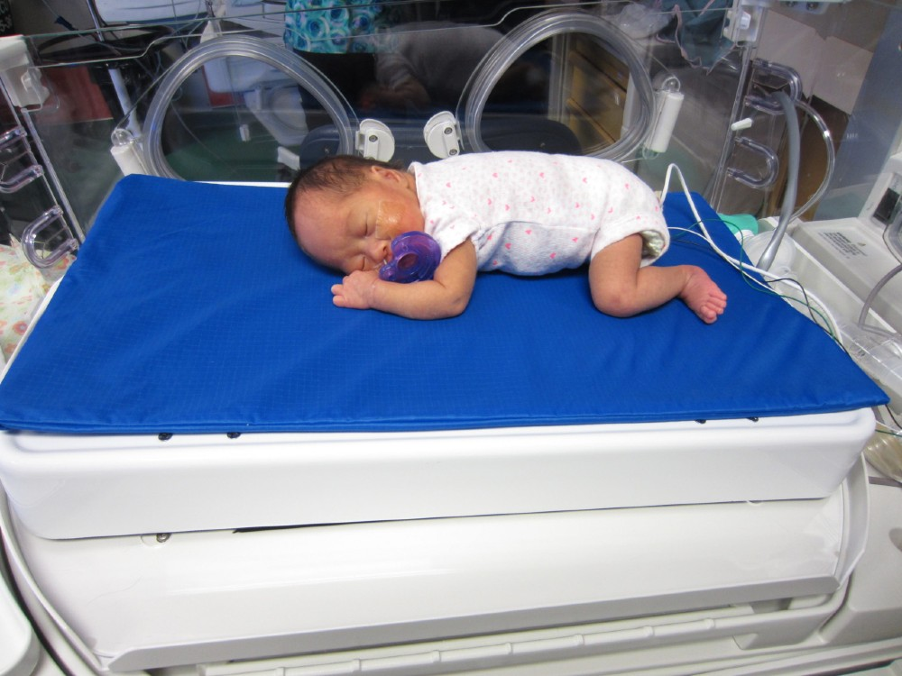 Premature baby resting on Calmer in the NICU at BC Children's Hospital. Photo credit: Liisa Holsti