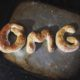 Three homemade baked pretzels spell out OMG