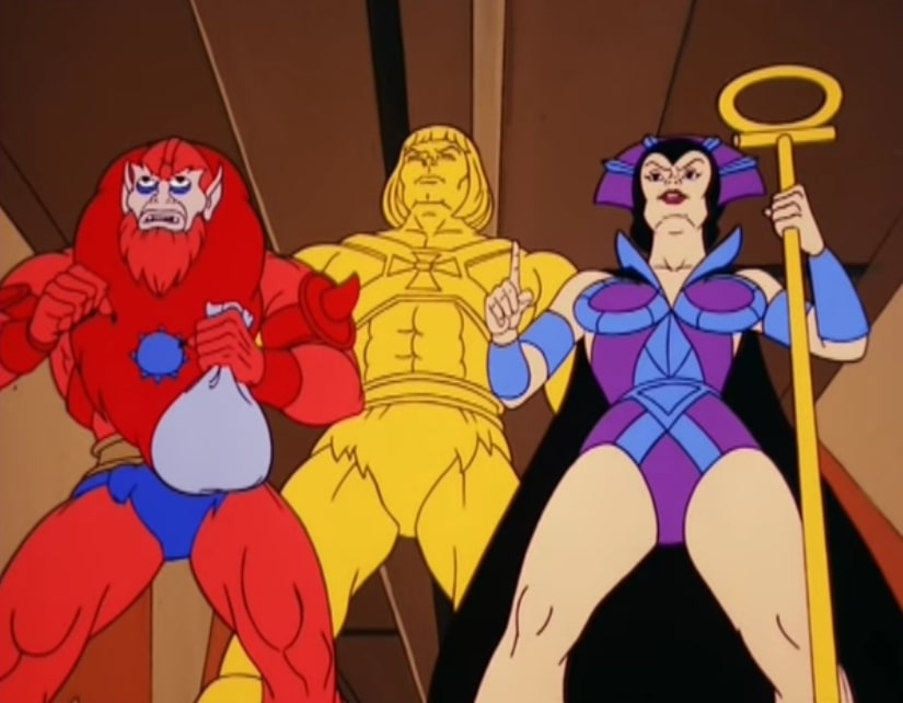 Beast Man and Evil-Lyn stand with a solid gold He-Man
