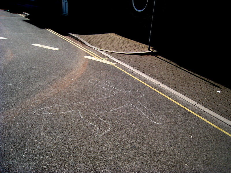 A chalk outline on a street. (Photo by Mike Andrews via Flickr/Creative Commons https://flic.kr/p/4CNoCx)